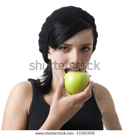 A girl eats a green apple - stock photo