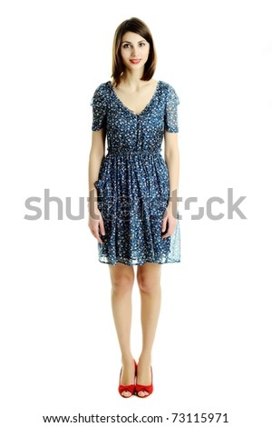 A girl in a dress with a floral pattern - stock photo