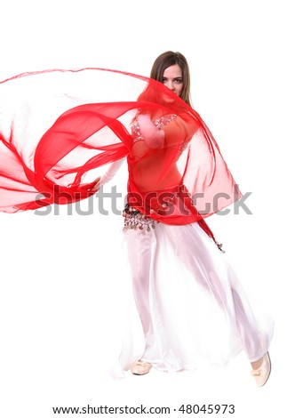 A girl in a fancy eastern costume dancing - stock photo