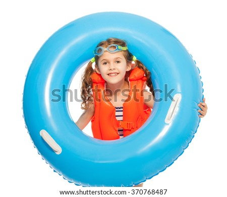 A girl in lifejacket and goggles with rubber ring - stock photo