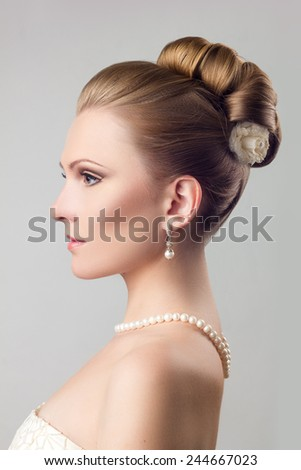 A girl in pearl necklace with wedding hairstyle  - stock photo