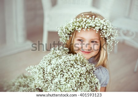 A girl is looking away. Her smile is engaging, her eyes are attractive.  - stock photo