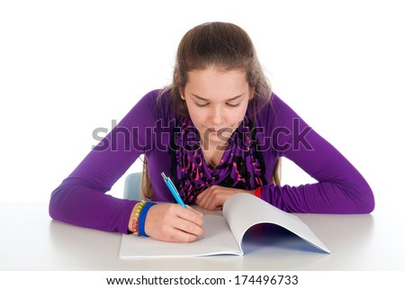 a girl is making her homework, on a white background - stock photo