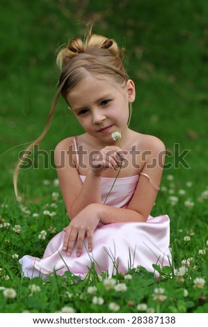 A girl is posing on the grass - stock photo