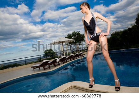 a girl near the swimming pool - stock photo