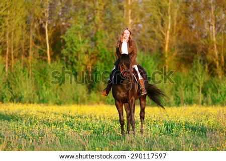 A girl riding a horse - stock photo