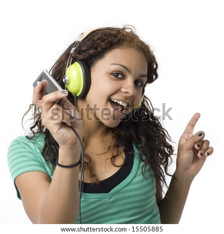 A girl sings along with her headphones and media player - stock photo