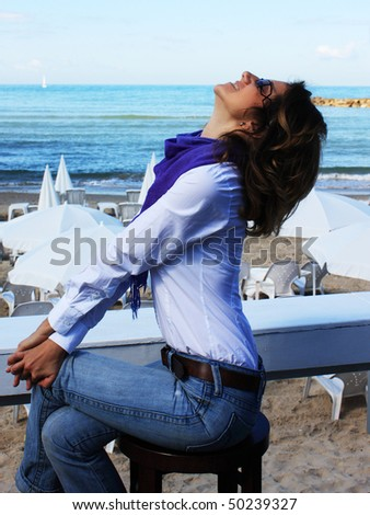 A girl sits alone in a cafe and looking at the sky - stock photo