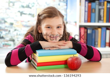 A girl takes a short break at school - stock photo