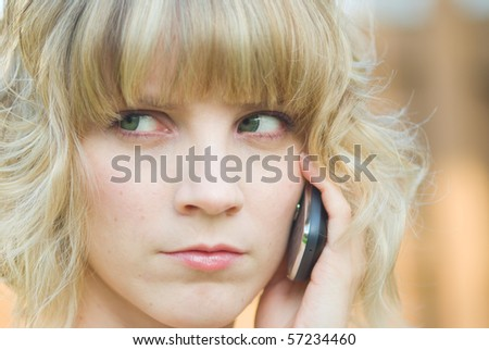 A girl talking on a phone - stock photo