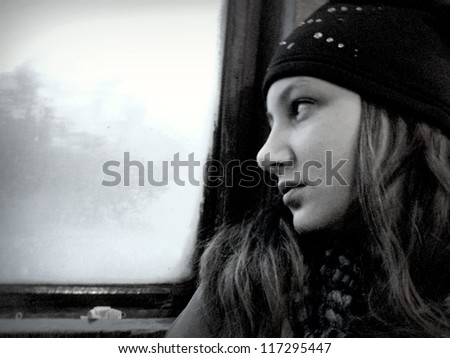 A girl teenager in the doldrums   artistic design  a large grain size, black and white contrast - stock photo