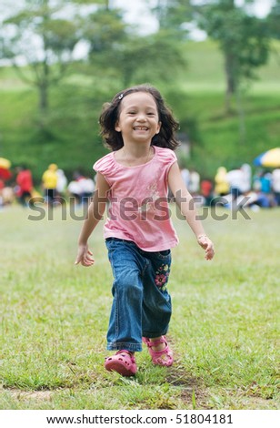 a girl walking and running - stock photo