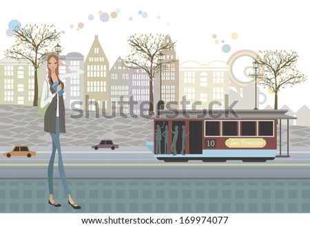A girl walking down the road as a trolley drives by. - stock photo