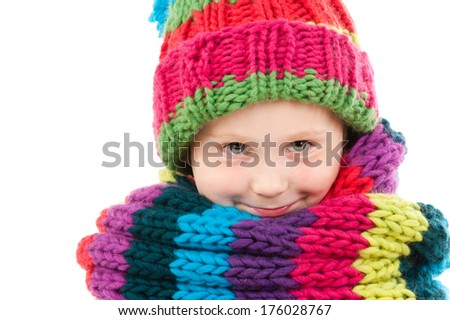 A girl wearing a colorful scarf and hat. - stock photo