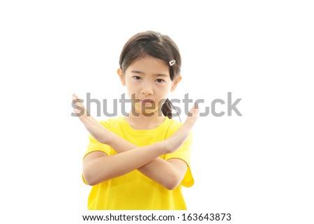 A girl who doing X mark - stock photo