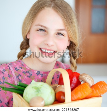 a girl  with a basket full of fruits - stock photo