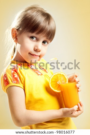 A girl with a glass of juice - stock photo
