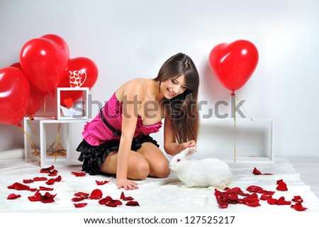 A girl with a rabbit on Valentine's Day - stock photo