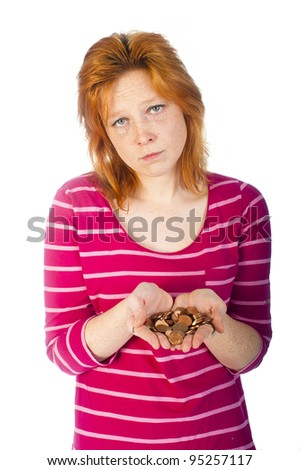 a girl with coins in her hand - stock photo