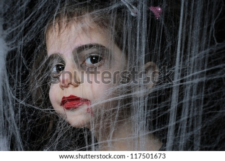 A girl  with Halloween vampire make up - stock photo