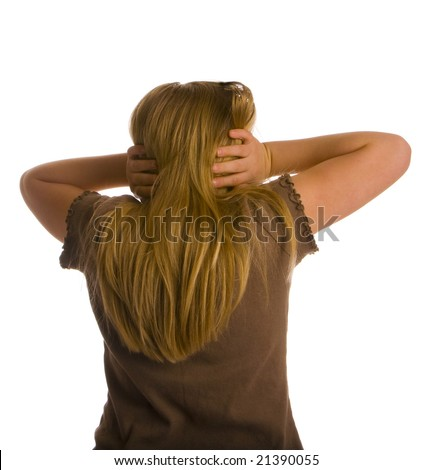 A girl with her back turned and ears covered. - stock photo