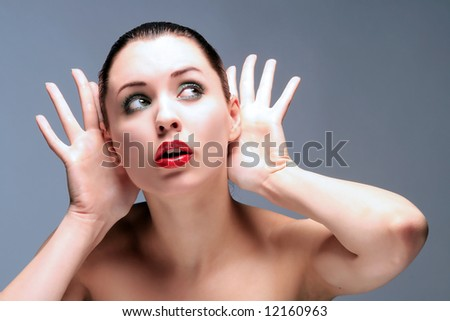 a girl with red lips is listening something - stock photo