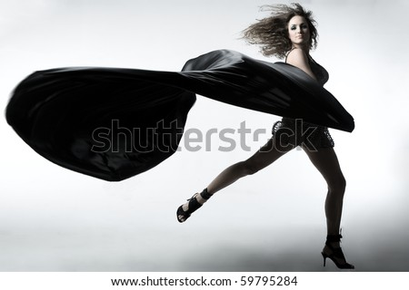 a girl with silk textile - stock photo