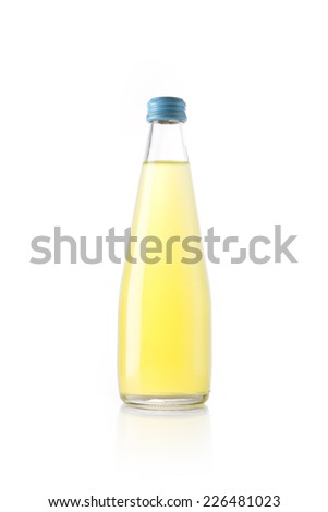 A glass bottle with yellow soft drink reflective bottom isolated white. - stock photo