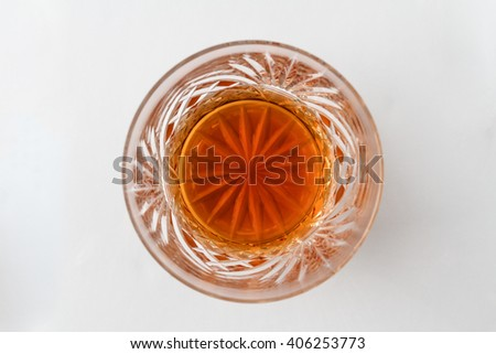 A glass containing a double scotch with no ice, from above - stock photo