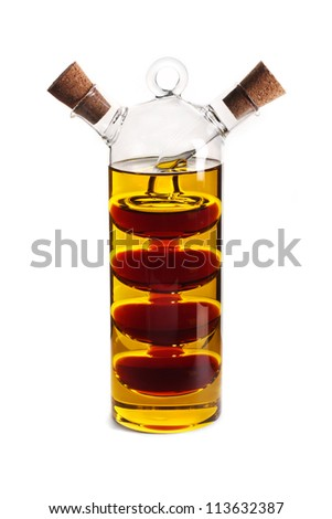 A glass cruet with olive oil and balsamic vinegar isolated over a white background. - stock photo