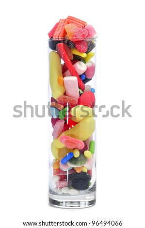 a glass jar full of candies on a white background - stock photo
