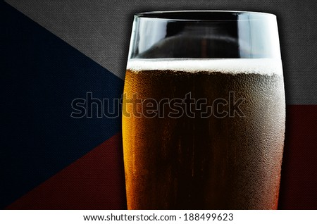 A glass of beer. Czech Republic flag in the background. One of the countries where beer consumption is highest in the world. - stock photo