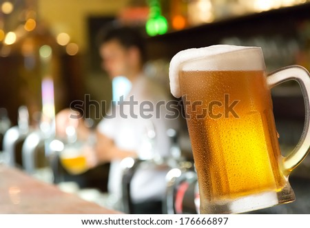 a glass of beer in the pub - stock photo