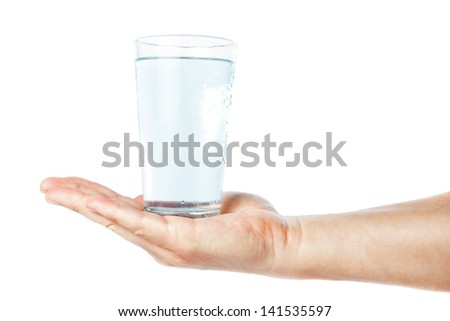 A glass of clean and fresh water in the hand of man. On a white background. - stock photo