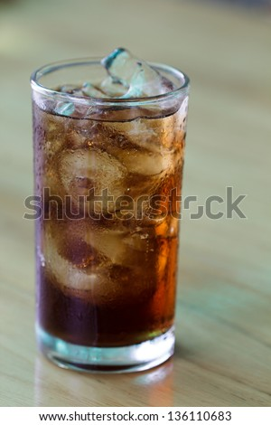 A glass of cola with ice cubes - stock photo