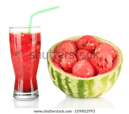 A glass of fresh watermelon juice and half watermelon isolated on white - stock photo