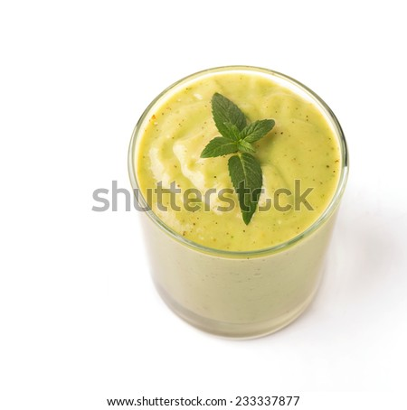 A glass of green smoothie isolated on white background - stock photo