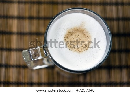 A glass of hot colorfull cofee with milk - stock photo