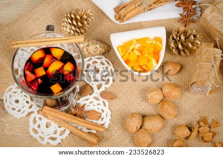 A glass of hot glogg surrounded by ingredients - stock photo