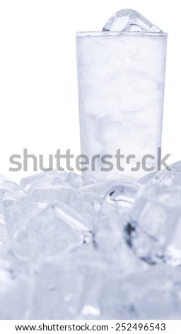 A glass of iced water and ice cubes  - stock photo