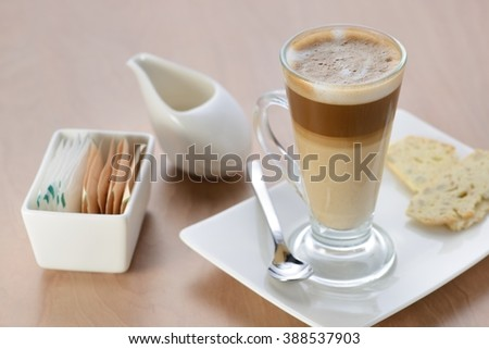 A glass of latte - stock photo