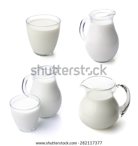 A glass of milk and a milk jug isolated on white  - stock photo