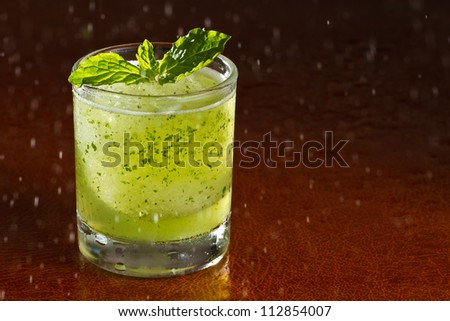 A glass of Mojito, a kind of cocktail drink - stock photo