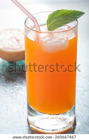 A glass of orange flavored carbonated drink - stock photo
