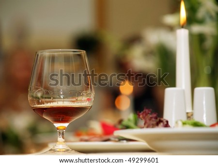 a glass of red wine is on a beautiful holiday table - stock photo