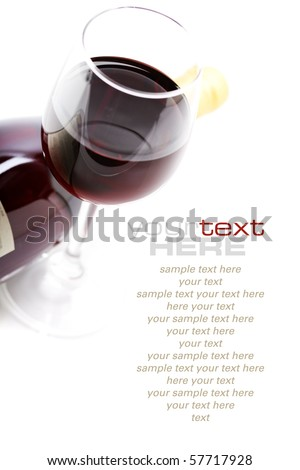 a glass of red wine over white  (with sample text) - stock photo