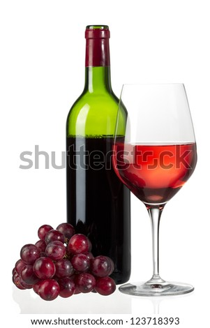 A glass of red wine with grapes and wine bottle isolated on white - stock photo