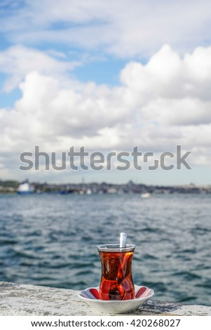 A glass of Turkish tea against sea in istanbul, Turkey - stock photo