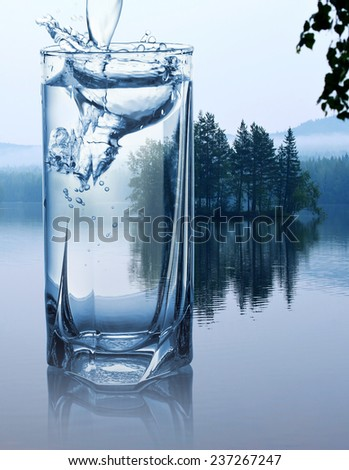 A glass of water on a background of nature - stock photo