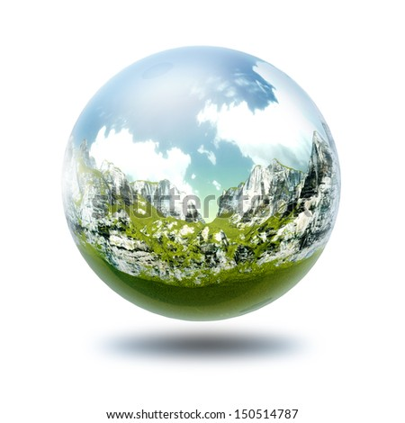 A glass transparent ball with mountains inside it.  - stock photo